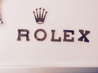 Rolex Schriftzug Bild