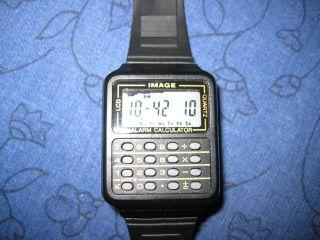 Armbanduhr Mit Taschenrechner - Schöner Gag Für Den Adventskalender Bild