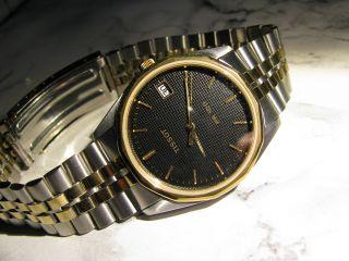 Tissot Pr 100 Herren - Armbanduhr Mit Datummsanzeige In Bicolor Mit Quarzwerk Bild