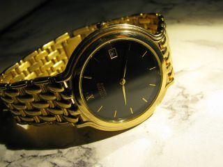 Citizen - Herren Armbanduhr Mit Datumsanzeige Und Quarzwerk Vergoldet Bild