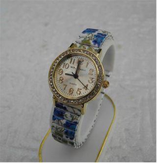Bezaubernd Damen Uhr - Flexi Uhrband - Blau - Rosen - Mit Steinen Besetzt - Top Bild