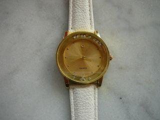 Uhr Armbanduhr Gold Weiß Mit Beweglichen Glitzer Steinen Bader Modeuhr Bild