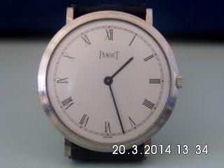 Hau/unisex,  Piaget,  Handaufzug 4mm Flach Massiv 750 / 18k Weiß - Gold,  Läuft Top Bild