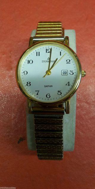 Schöne Goldfarbende Dugena Saphir Damenuhr Uhr Flexarmband Deckel Ist Goldfarben Bild