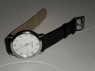 Orig.  Magnum Unisex Uhr Mit Schwarzem Band Neuwertig Bild