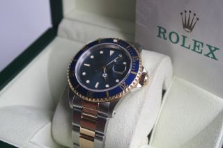 Rolex Submariner St/gold 16613 Mit Restgarantie Bild
