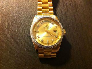 Rolex Day - Date - Borke Gold750/18karat Herrenuhr/brillantbesatz Automatik/chronom Bild