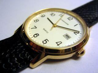 Junghans Quarz Armbanduhr,  Goldfarben,  Quartzuhr,  Ungetragen,  Ovp,  Am Lederband Bild