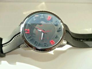 Armbanduhr,  Schwarz,  Silikonarmband 23cm Lg.  3d - Ziffernblatt Analog ø5cm. Bild