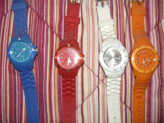 Vier Damen Armband Uhren,  Kunststoff (blau,  Orange,  Weiß U.  Rot) Bild