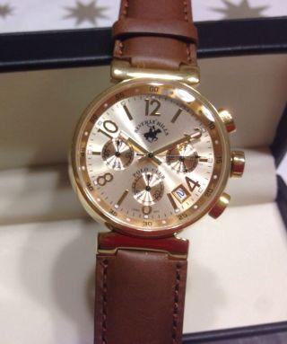 Elegante Herrenuhr / Armband Uhr Edelstahlgehäuse Goldfarbenes Ziffernblatt Bild
