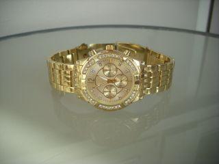 Mode Uhr,  Fashion Uhr In Gold Armbanduhr Damenuhr Herrenuhr Mit Strasssteinen Bild
