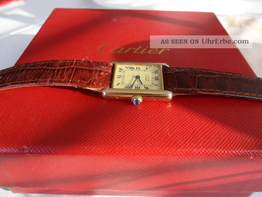 Cartier Damenuhr Tank Armbanduhren Bild