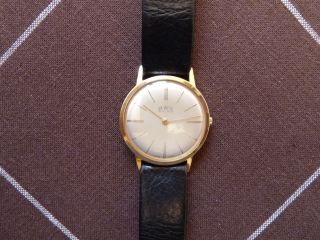 Bwc Swiss / Flache Armbanduhr / Mechanik / Handaufzug / 20 Micron Gold / Um 1960 Bild