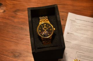 Astron Armbanduhr Vergoldet Bild