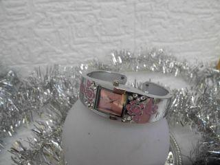 Damen Spangen Uhr - Spange Mit Rosa Blümchen Florales Design - Zifferblatt Rosa Bild