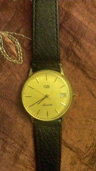 Cito Armbanduhr - Goldenes Zifferblatt - Braunes Armband Mit Datum Bild