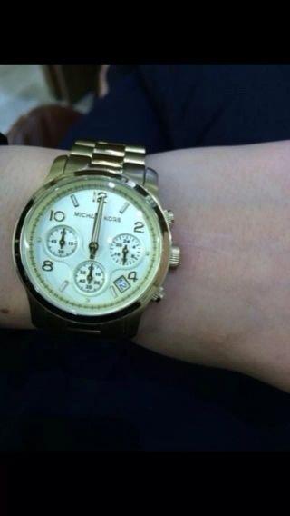 Michael Kors Uhr Gold. Bild