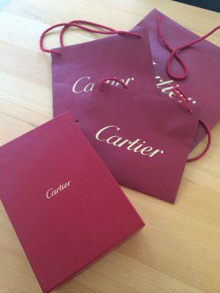 Cartier Schmuckbox Und Tüten Bild