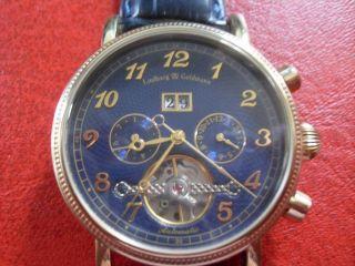 Lindberg & Goldmann Automatic Herrenuhr Goldfarbig,  Großdatum,  Zifferblatt Blau Bild