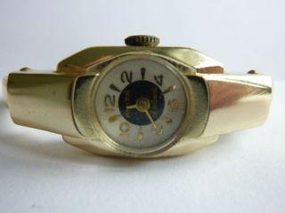 Goldfarbige Arm - Spangenuhr