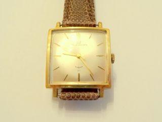 Die Besondere: Ducado - Rechteck - Uhr,  Geschmeidiger Handaufzug,  Movado - Schließe Bild
