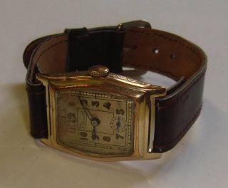 Antike Herrenuhr Record,  Art - Déco 1930/40er Jahre,  Goldfarbenes Uhrwerk Bild
