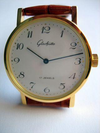 Glashütte,  Herrenarmbanduhr Mechanische Uhr Vergoldet.  Ungetragen. Bild