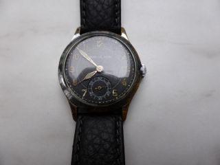 Armbanduhr Jaeger Le Coultre,  Etwa 1940,  Schwarzes Blatt Bild