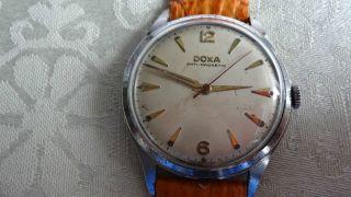 Doxa Handaufzug,  Präzisions - Manufakturwerk Doxa Kal.  103 Bild