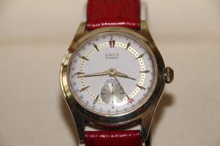 Osco Parat Armbanduhr,  Zeigerdatum,  Handaufzug,  Ca.  1940,  Vergoldet,  Unisex Bild