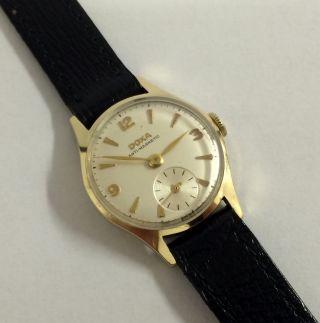 Vintage Doxa 14k,  585 Gold,  Handaufzug Damen Uhr. Bild