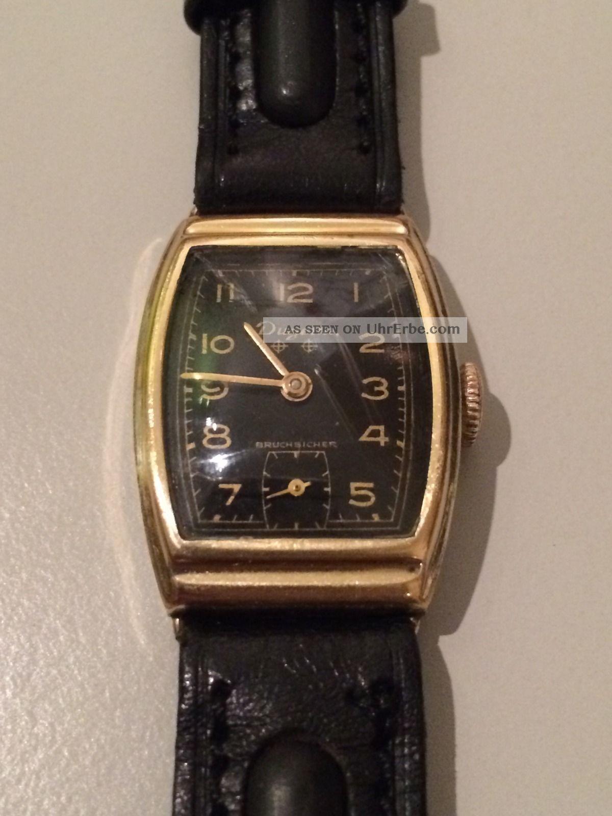Dugena Armbanduhr / Handaufzug / Kal.  42 Parat / Herrenuhr / Gold - Schwarz Armbanduhren Bild