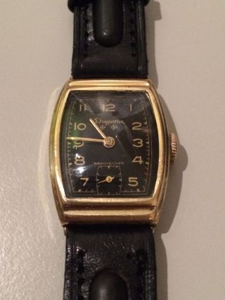 Dugena Armbanduhr / Handaufzug / Kal.  42 Parat / Herrenuhr / Gold - Schwarz Bild