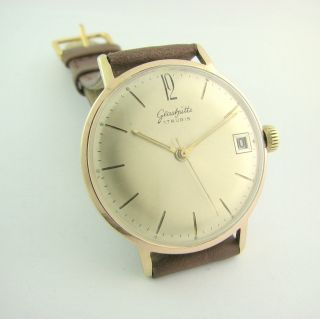 Top.  Glashutte 17 Rubis.  Big Case.  Gold Plated.  Cal.  69.  1.  Check It Bild