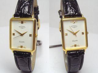 Rotary Goldene Swiss Made Armbanduhr Mit Neuem Kroko Armband Bild