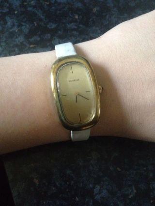 Dugena Uhr Vergoldet,  Weisses Band Bild