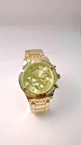 Mode Uhr In Gold Armbanduhr Damenuhr Herrenuhr Mit Strasssteinen Bild