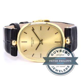 Armbanduhr Patek Philippe Ellipse 18kt Gelbgold Handaufzug Gold Zifferblatt Bild