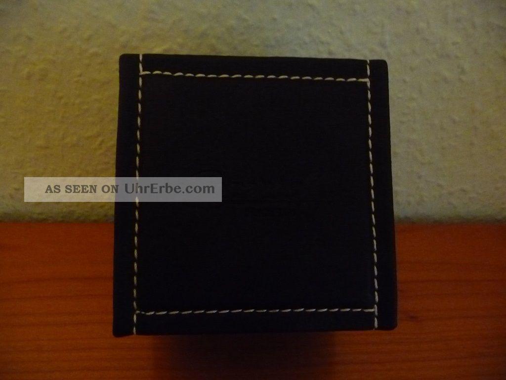 herrenarmbanduhr marke ingersoll mit schwarzem lederarmband verpackt