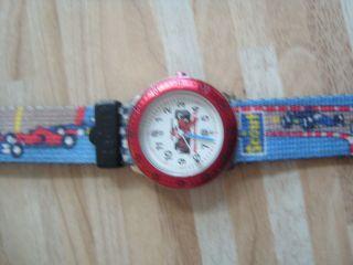 Scout Armbanduhr Rennautos Für Jungen Funktionstüchtig Mit Neuer Batterie Bild