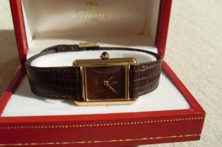 Cartier Uhr Braun Bild