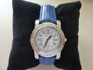 M.  Johansson,  Armbanduhr,  Röm.  Ziffern,  Silber,  Blaues Leder,  Wasserresistent Bild