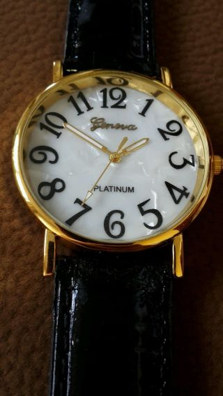 Schwarze Uhr Geneva Bild