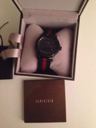 Gucci Unisex - Armbanduhr G Timeless Sport Analog Quarz Nylon Bild