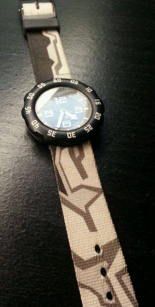 Flik Flak Uhr Kinder Schwarz Braun,  Verpackung Bild