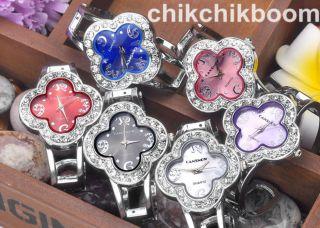 Damen Kleeblatt Silber Gehäuse Armbanduhr Kristall Analog Quarzuhr Armreif Uhr Bild