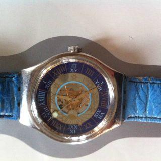 Swatch Platin Tresor Magique Bild