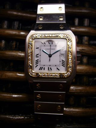 Cartier,  Santos De Cartier,  Edelstahl,  18k,  750 Gelbgold,  Diamanten - Lunette. Bild