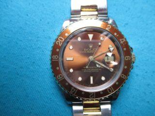 Rolex Gmt Master 2,  Stahl/gelbgold,  Tigerauge Zifferblatt Bild